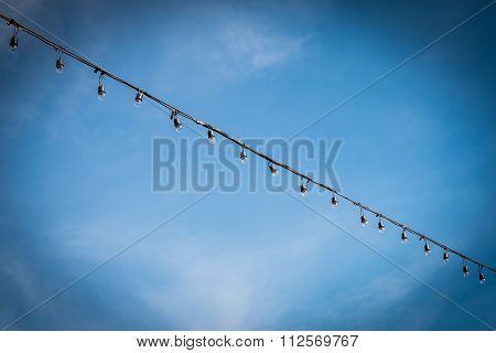 Closeup Of The Hanging Light Bulbs With Blue Sky 2
