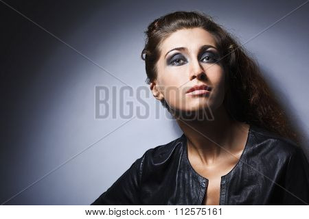studio portrait of pretty fashionable girl