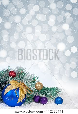 Christmas Tree And Blue Balls On Bokeh Background