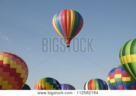Single Hot-air Balloon Floating Above A Balloon Festival