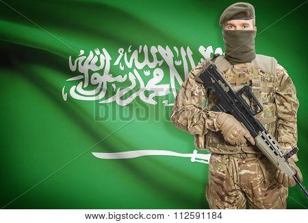 Soldier Holding Machine Gun With Flag On Background Series - Saudi Arabia