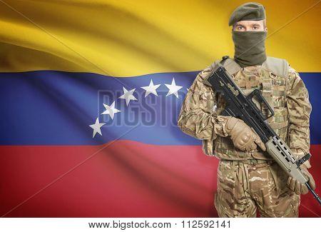 Soldier Holding Machine Gun With Flag On Background Series - Venezuela