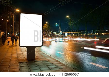 Blank advertising billboard in the city at night.