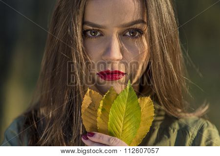 Holding Autumn Leaves.