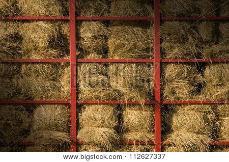 Hay Bales Piled Within A Cart Lit Diagonally