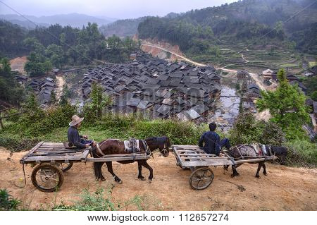 Two Carts With Chinese Peasants Passing Along Mountain Road, Spring.
