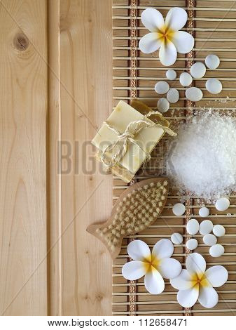 Soap And Fish Shaped Brush On The Wooden Background