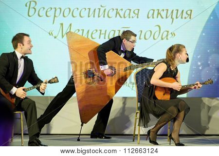 ST. PETERSBURG, RUSSIA - DECEMBER 14, 2015: Group Balalaika from Syktyvkar preform during the award ceremony Philanthropist of the Year at the 4th St. Petersburg International Cultural Forum