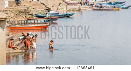 Men bathing in the river Ganges in Varanasi