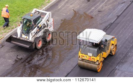 Small Road Construction Machinery At Work.