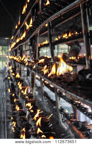 Rows Upon Rows Of Oil  Lamp Offerings