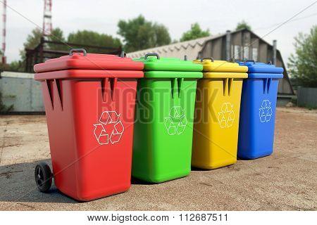 Multicoloured Garbage Trash Bins over industrial background poster