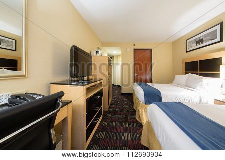 USA, NEW-YORK - 07 SEP, 2014: Small stylish bedroom with two beds and TV in Holiday Inn Express, Wall Street.