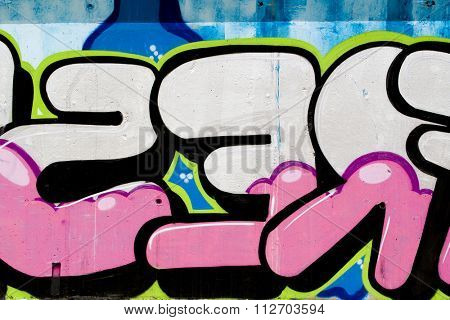 typography and color lines, segment of an urban grafitti on wall