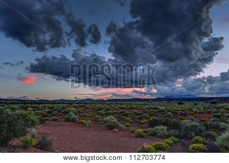 Desert vista at sunset near Flagstaff Arizona with the San Francisco Peaks in the distant background. poster