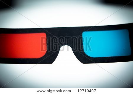 3d three dimensional glasses to watch 3-d films on television photo. poster