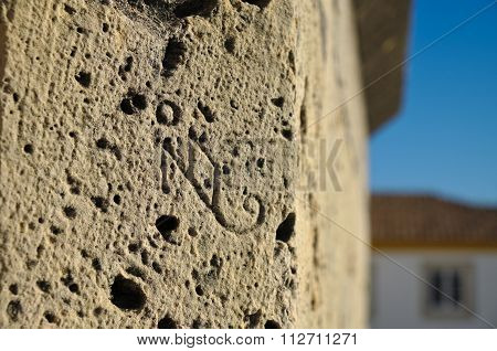 Stonemason's signature engraved on a stone