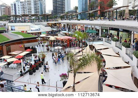 LIMA, PERU - OCTOBER 18, 2015:  Larcomar Mall in Miraflores, Peru. Shoppers in the outdoor mall that sits between the ocean and Alfredo Salazar Park.