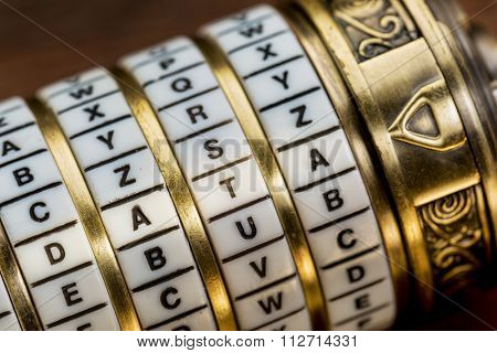 data word as a password to combination puzzle box with rings of letters