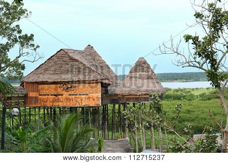 IQUITOS, PERU - OCTOBER 17, 2015: Ajarys Restaurant. Built on poles to stand above the Itaya-Amazon during the wet season.