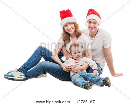 young couple with little boy and presents on the floor isolated on white background