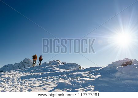 Group Hikers In Winter Mountains, Beautiful Landscape And Blue Sky