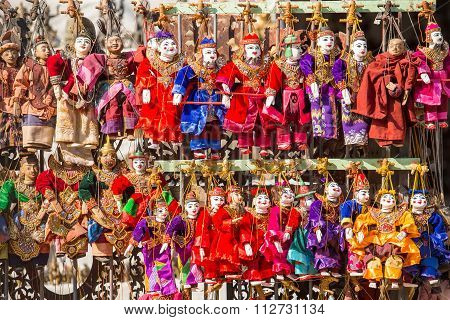 Puppet souvenir, Myanmar tradition dolls on street market. poster