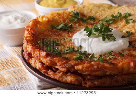 Swiss Breakfast: Potato Flapjacks With Sauce Macro On A Plate. Horizontal