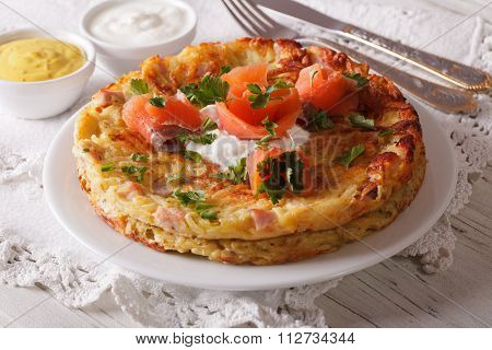 Swiss Breakfast: Rösti With Salmon On A Plate Close-up. Horizontal