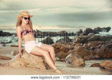 Attractive Blonde With Hat And Sunglasses Leaning Backwards