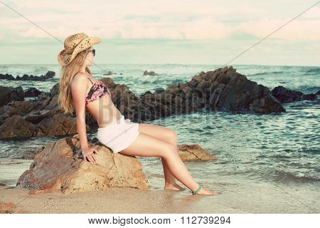 Attractive Blonde With Hat And Sun glasses Looking Away