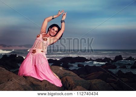 Belly Dancer Performing On The Rocks