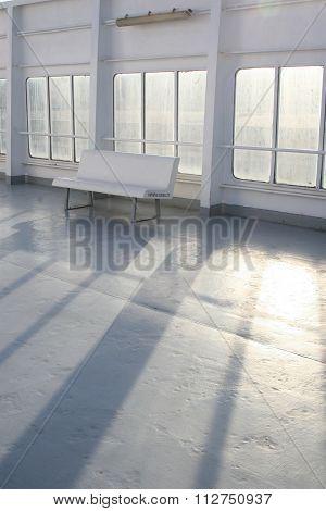 White bench on the ferry bridge