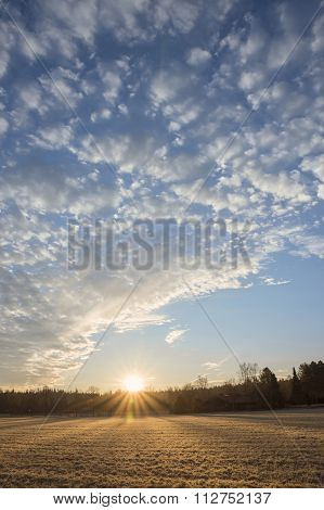 Sunrise Over The Frosty Field, Blue Sky With Clouds