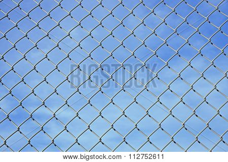 Mesh Wire Fence And Blue Sky