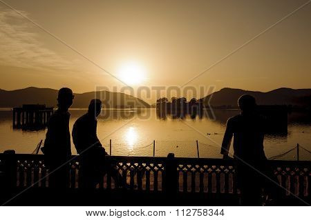 Silhouette of local Indian young boys in the palace Jal Mahal at sunrise.