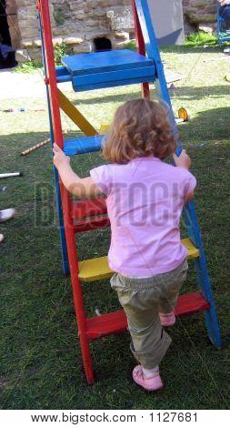 Girl Playing/ Climbing Ladder