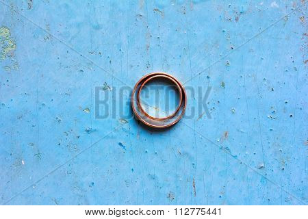 Wedding gold rings on a blue background