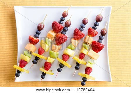 Fresh Fruit Shish Kebabs On A Modern Square Plate