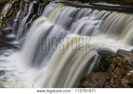 Sgwd y Pannwr Falls waterfall. Pontneddfechan Vale of Neath Powys Wales United Kingdom winter. poster