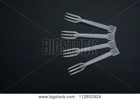 4 Plastic Disposal Forks On Black
