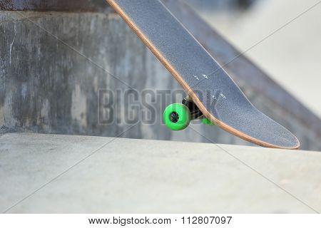 closeup of one skateboard at skate park