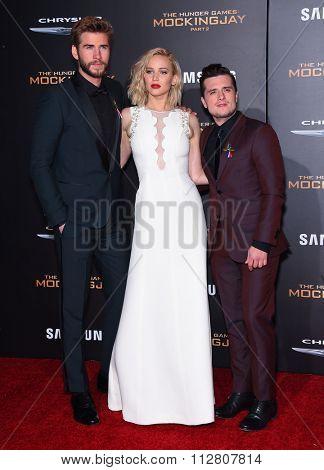 LOS ANGELES - NOV 16:  Liam Hemsworth, Jennifer Lawrence & Josh Hutchinson at