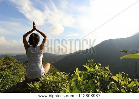 young fitness woman practice yoga on mountian peak