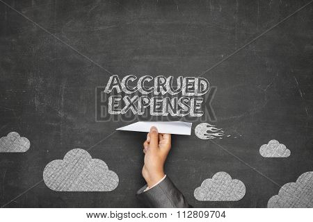 Accrued expense concept on blackboard with paper plane