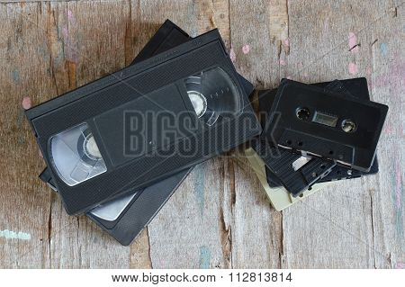 video tape and cassette tape on wood board