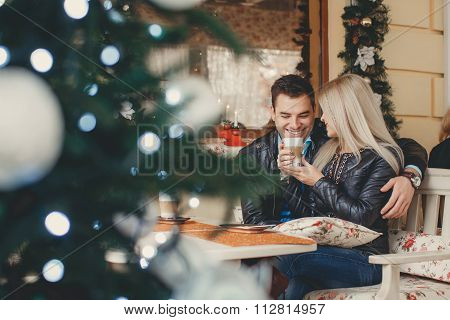 Beautiful young couple at a table in a cafe