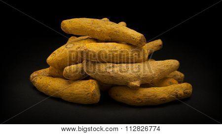 Pile of Organic Long Turmeric (Curcuma longa)