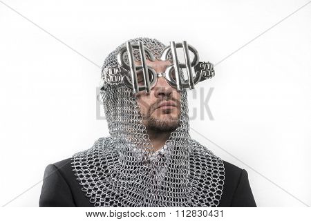 invest, businessman with medieval executioner in metal and silver glasses. concept of protection of savings and money