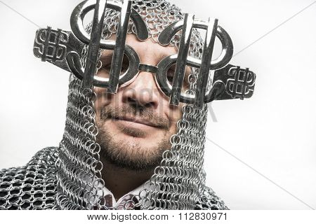 happy, businessman with medieval executioner in metal and silver glasses. concept of protection of savings and money